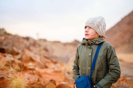 Young girl outdoor at Namib desert on cold winter evening Zdjęcie Seryjne