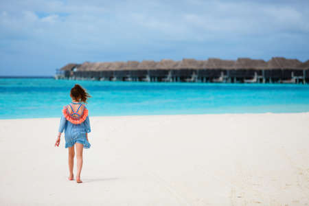 Back view of young girl at beach during summer vacation