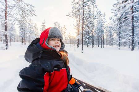 Adorable little girl wearing warm clothes outdoors on beautiful winter snowy day 写真素材 - 155235363