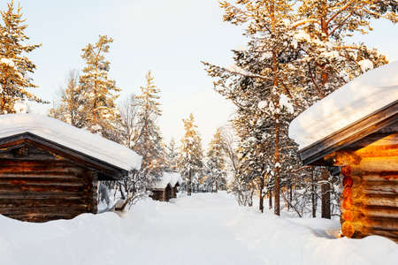 Beautiful winter landscape with wooden hut and snow covered trees Zdjęcie Seryjne