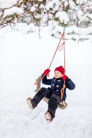 Adorable little girl having fun outdoors on beautiful winter snowy day