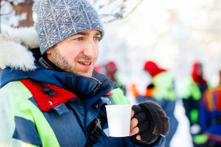 Young man enjoying winter tour outdoors on beautiful day in Lapland Zdjęcie Seryjne - 155235507