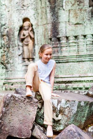 Little girl in ancient Angkor Wat temple in Siem Reap, Cambodia Zdjęcie Seryjne