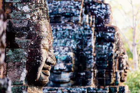 Faces of ancient Bayon temple popular tourist attraction in Angkor Thom, Siem Reap, Cambodia 写真素材 - 159893708