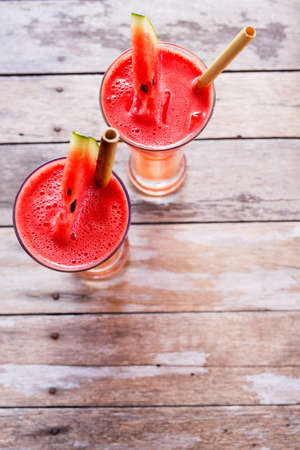 Top view of tropical watermelon juice on a table 写真素材