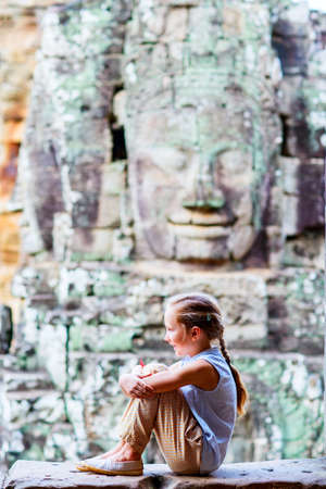 Little girl in ancient Angkor Wat temple in Siem Reap, Cambodia 写真素材