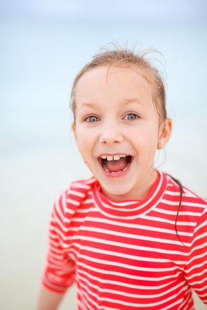 Portrait of adorable playful little girl