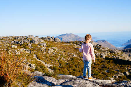 Little girl enjoying breathtaking views of Cape Town from top of Table mountain in South Africa
