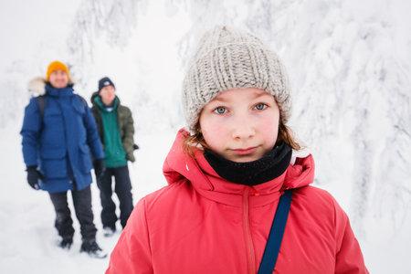 Beautiful family enjoying snowy winter day outdoors