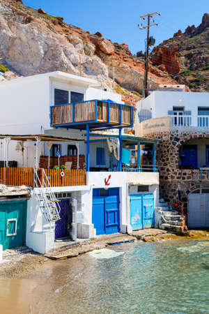 Traditional fishing village of Firopotamos with white houses and colorful doors on Milos Island in Greece