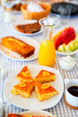 Delicious orange pie served for breakfast with fresh juice and cup of hot coffee