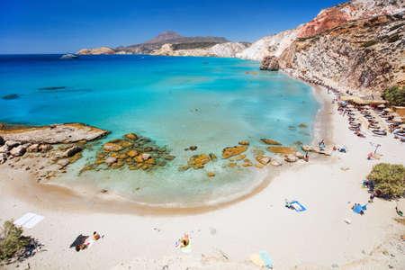 Idyllic Fyriplaka beach surrounded by beautiful cliffs on Greek island of Milos