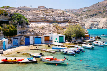 Traditional fishing village of Firopotamos with white houses and colorful doors, small harbor and fishing boats on Milos Island in Greece Zdjęcie Seryjne