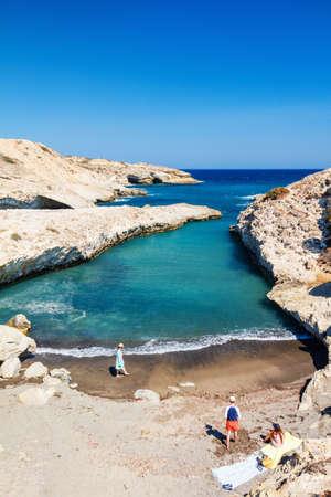 Family mother and kids enjoying idyllic beach on Greek island of Milos