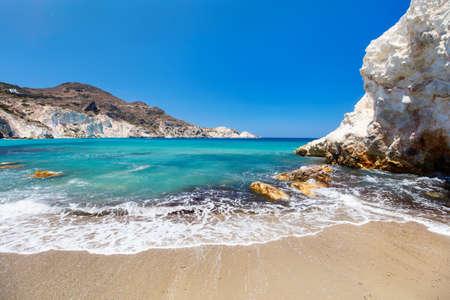 Idyllic beach surrounded by beautiful cliffs on Greek island of Milos Zdjęcie Seryjne