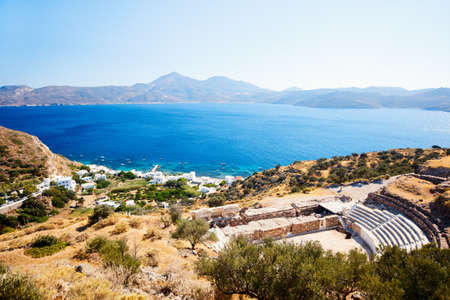 Breathtaking landscape of Milos island in Greece with ancient theater on foreground