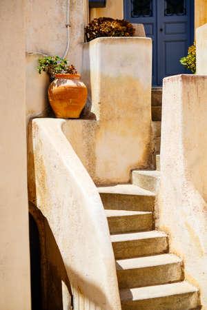 Close up details of quiet street in Pyrgos village on Santorini island in Greece