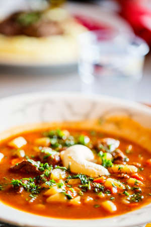 Bowl of delicious tomato meat soup served for lunch in a restaurant