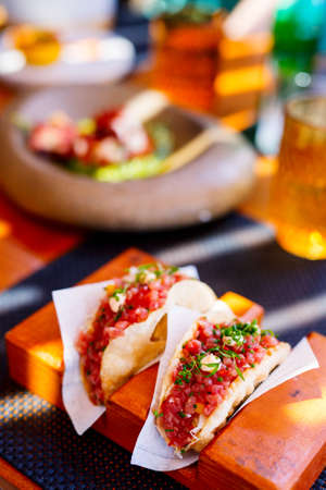 Close up of fresh delicious tuna tacos served for lunch in restaurant