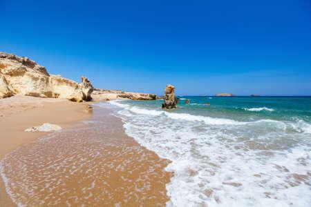 Idyllic beach surrounded by beautiful cliffs on Greek island of Milos 免版税图像