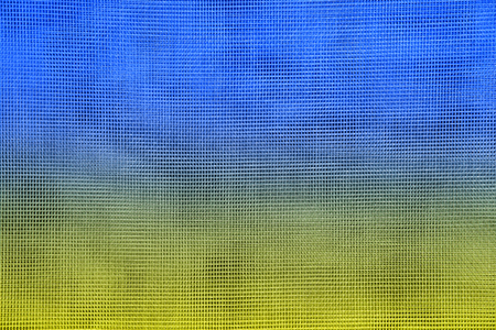 The national flag of Ukraine on the grid. Texture