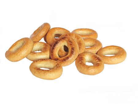Small heap of golden bagels photo