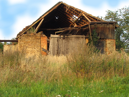 Abadoned barn ruin on the edge of the village