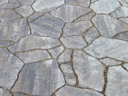 Texture gray natural stone garden pavement, decorative mosaic