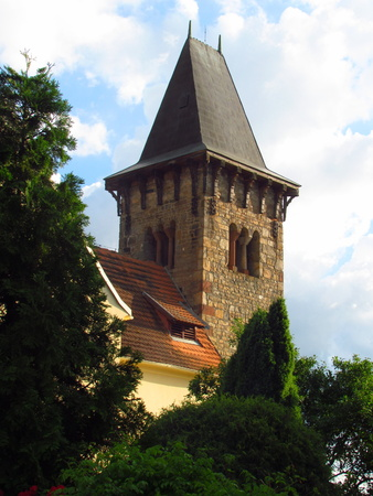 Old rural church with a Romanesque tower, detail of tower, Pertoltice village, Czech Republic