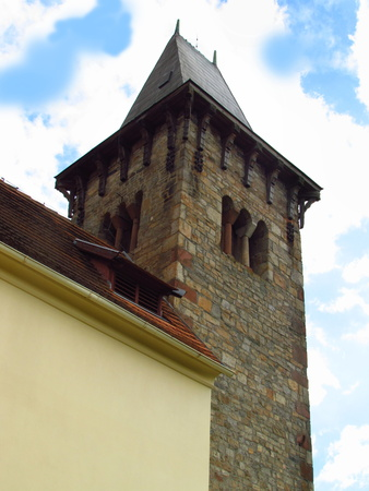 Romanesque tower, old rural church with a detail of stone tower, Pertoltice village, Czech Republic