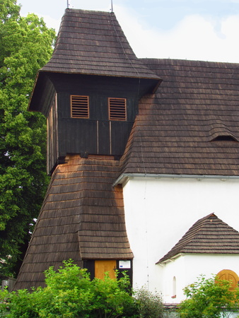 Folk village church with wooden tower and wooden roof, religious building from the 13th century, rural folk architecture