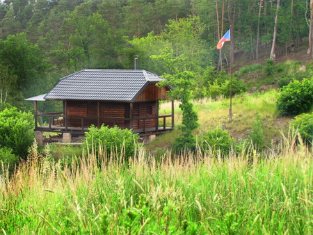 Wooden forest hunting hut, small cabin in the wood,