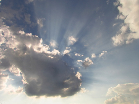 dramatic clouds backlit by the sun rays, background for a religious theme or text from the Bible