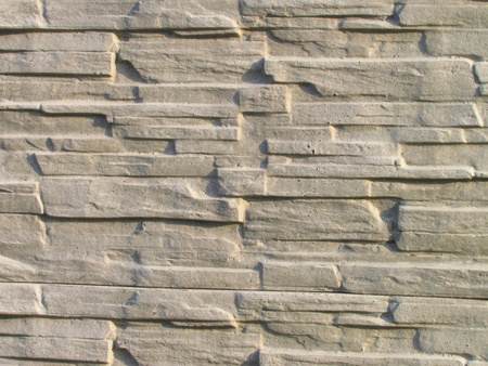 Wall of artificial stone, modern building material, photographic texture