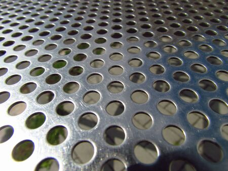 Stainless steel plate with holes, technical texture