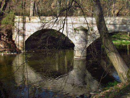 Stone bridge on river Blanice, public park in city Vlasim, central bohemia region