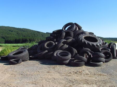 Pile of old tires. Problems of waste disposal. Environmental pollution