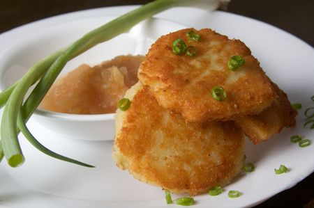 Latkes with Apple Sauce and Green Onion on a white plate photo