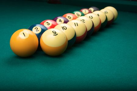 Billiard balls arranged in order from one to fifteen, shallow depth of field