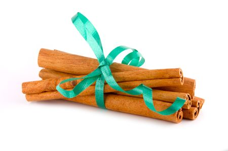 potherb: Cinnamon sticks bundled together with festive green ribbon
