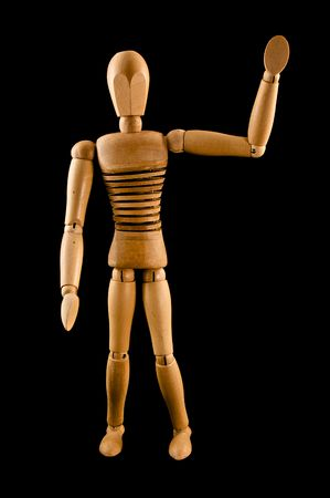 A wooden armature waves hello Stock Photo - 6378029