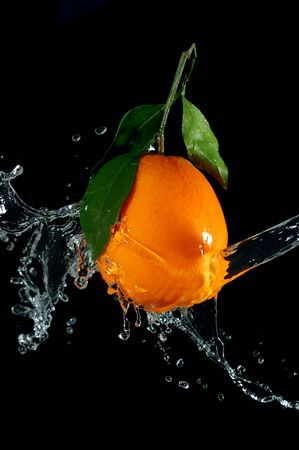 splashing orange photo