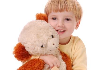 stuffed animal: Little cute boy with his teddy bear.