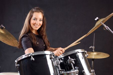 percussionist: Beautiful student on the drums lesson.