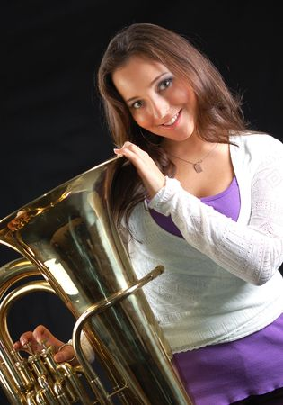 tuba: Beautiful girl with her musical instrument tuba.