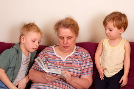 grandmother and her grandsons read the book