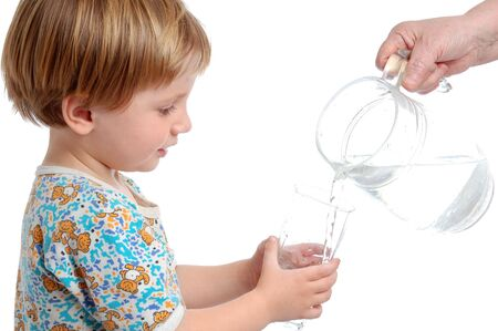 little boy with the glass of water photo