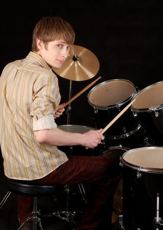 drum sticks: young musician beat the drums Stock Photo