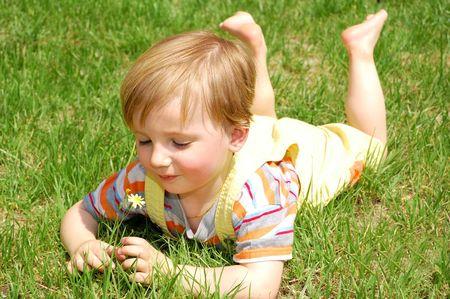 little boy lying on the grass Stock Photo - 5479584
