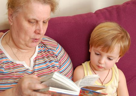 grandmother read the book for her grandson. Stock Photo - 5479579